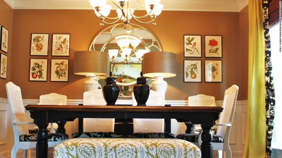 "Decorator and blogger Emily Clark used framed florals, a mirror and glossy paint finishes to reflect soft light in her <a href=""http://emilyaclark.blogspot.com/p/a-tour-of-our-last-home.html"" target=""_blank"">first home's dining room</a>."