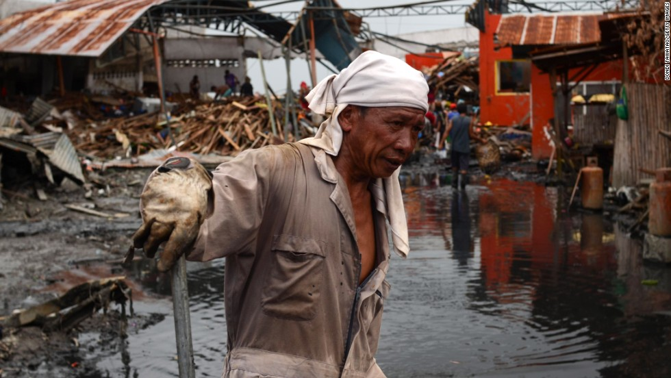 Workers clear mud and debris in Tacloban on November 20.