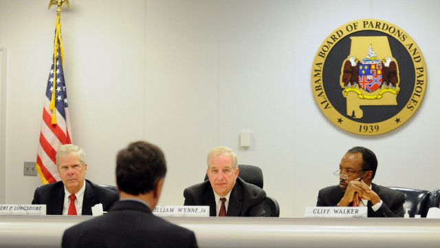 Robert Longshore, left, William Wynne, Jr. and Cliff Walker listen to Sen. Arthur Orr, R-Decatur, address the Alabama Board of Pardons and Paroles on Thursday, November 21 in Montgomery, Alabama.