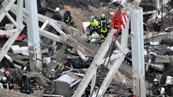 Rescue workers search through the debris of the Maxima supermarket in Riga on November 22.