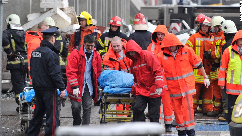 Rescue workers carry a victim on a stretcher outside the market on November 22.