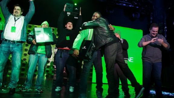 Fans cheer the release of Xbox One at a Microsoft launch event early Friday in New York.