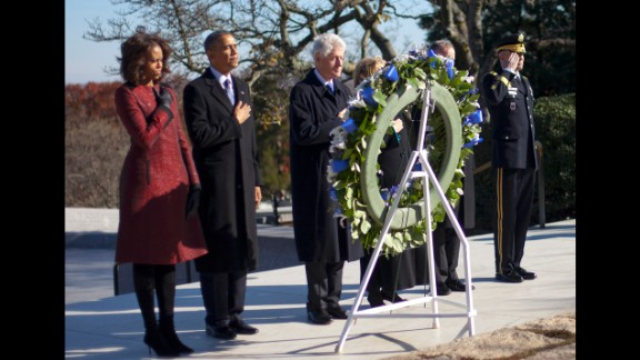 First lady Michelle Obama, President Obama, former President Bill Clinton and former Secretary of State Hillary Clinton pause during a wreath-laying ceremony Wednesday, November 20, at Arlington National Cemetery.