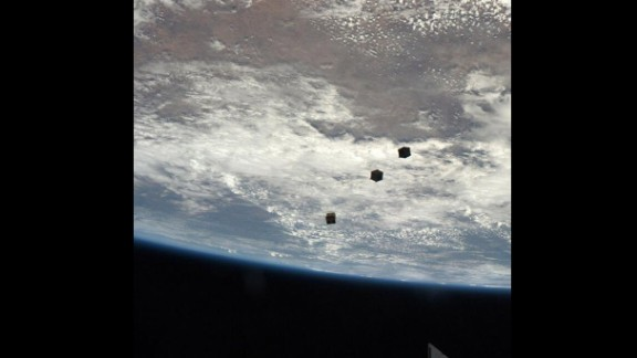 Drifting away: three nanosatellites, known as Cubesats, are deployed from the ISS airlock.