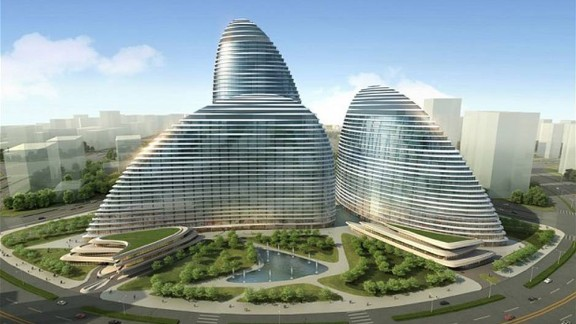 Wangjing SOHO is an office and retail complex in Beijing whose gently curving walls resemble Chinese fans embraced in an entrancing dance. The design, due to be completed in 2014, is meant to evoke the image of Koi, a traditional Chinese symbol of wealth, luck, health and happiness.