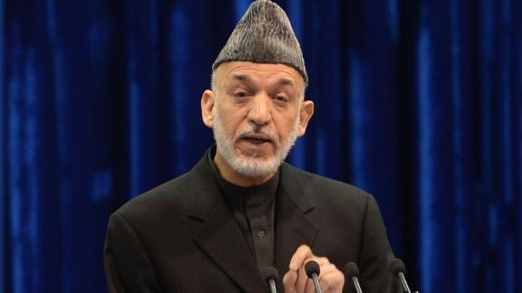Afghan president Hamid Karzai speaks during loya jirga in Kabul on November 21, 2013.