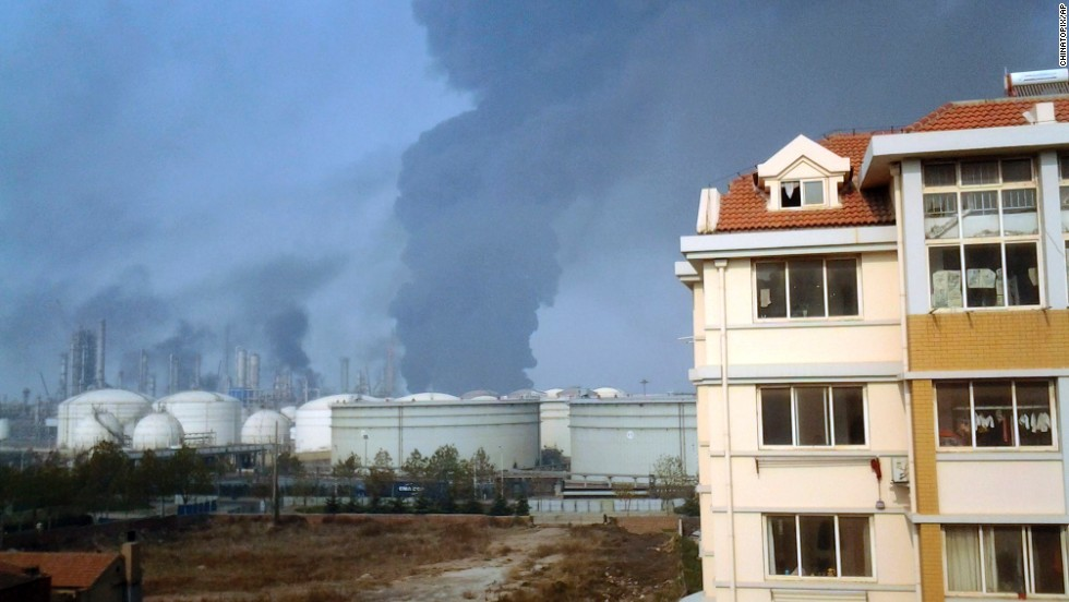 Smoke rises from oil refineries after the explosion November 22. The pipeline is owned by China's largest oil refiner, Sinopec.