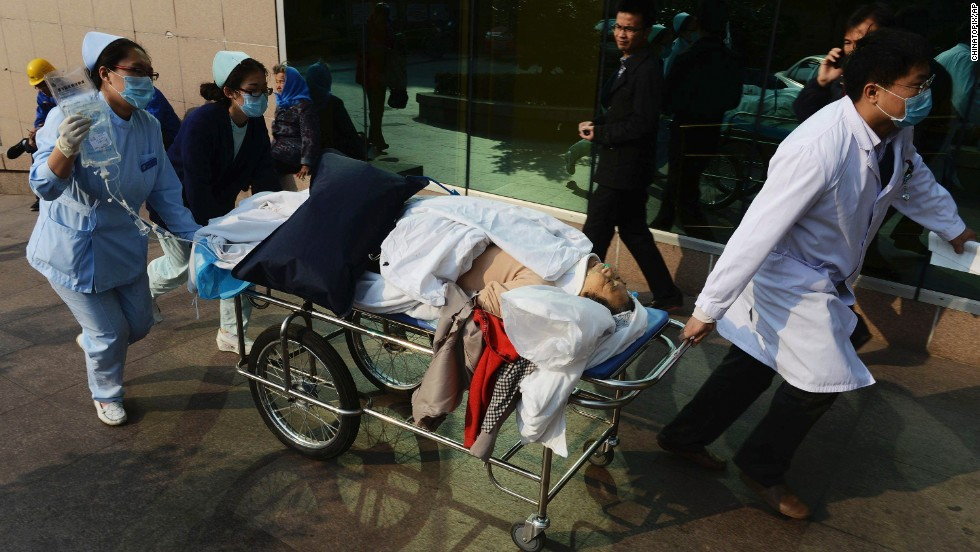 An injured person is wheeled to a hospital November 22.