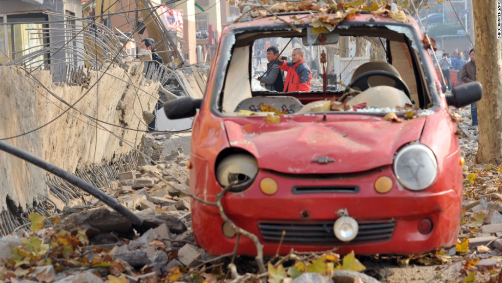A damaged vehicle is seen at the site of the explosion November 22.