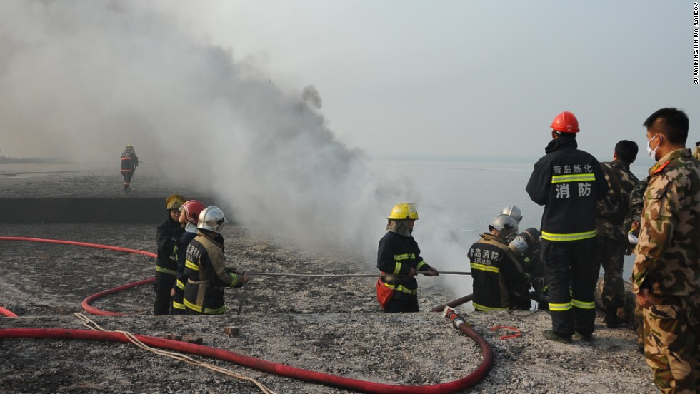 Firefighters work at the explosion site November 22.