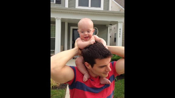 Ward gets a ride on his dad's shoulders.