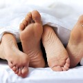 sex couple feet bed