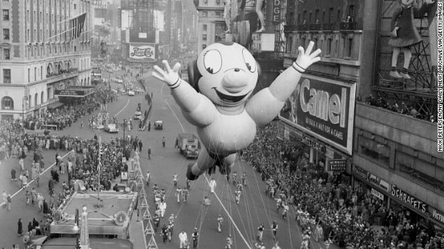 UNITED STATES - NOVEMBER 22:  One of characters Mighty Mouse in the annual Macy's Thanksgiving Day parade mugs for the crowd as he hogs the spotlight in Times Square. An estimated 400,000 watches the show.  (Photo by Nick Petersen/NY Daily News Archive via Getty Images)