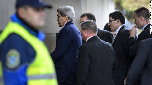 Secretary of State John Kerry, followed by bodyguards, enters the Intercontinental Hotel in Geneva for Iran talks on Saturday.