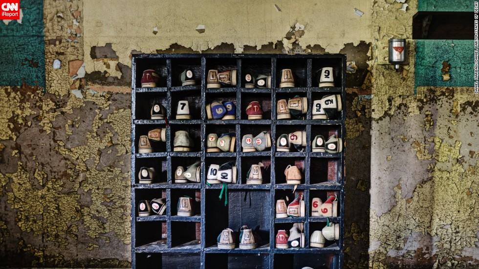 "For ""States of Decay,"" the photographers traveled through America's Rust Belt, a geographic term used to describe the economic decline of America's industrial heartland. They found a rack of forgotten bowling shoes in an old asylum in New York."