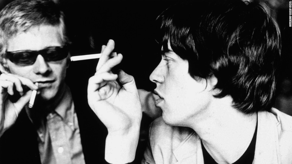 "Stones manager Andrew Loog Oldham and Mick Jagger. ""The big difference between the Beatles and the Stones were [that] the Beatles made it in America. The Stones were made <em>by</em> America,"" says Oldham."