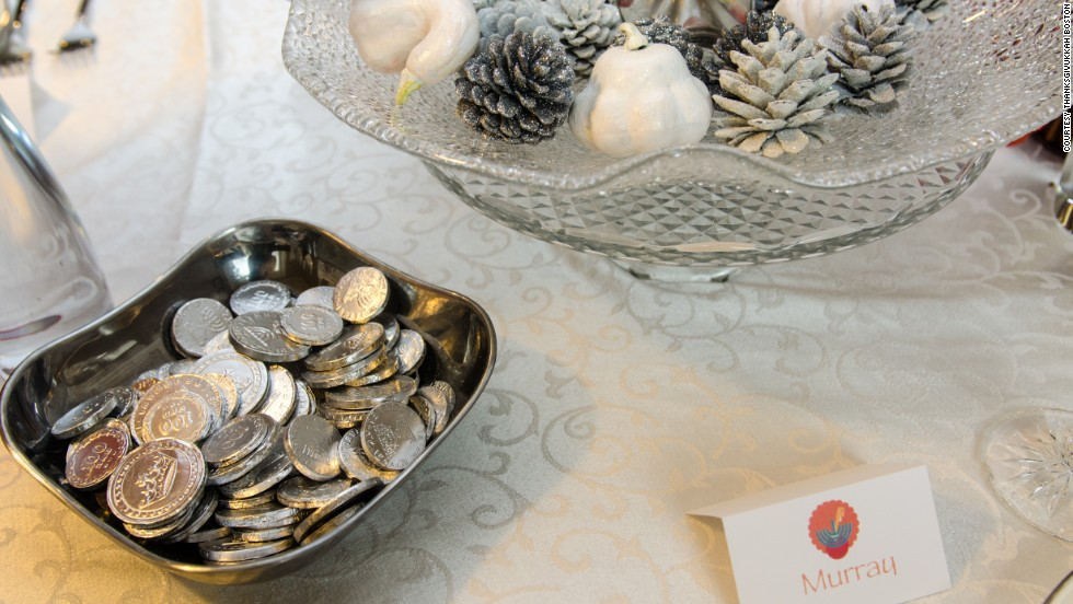 Many American Jews are decorating their tables this Thursday by mixing the two holidays of Thanksgiving and Hanukkah. This table has gelt, the coins traditionally given on Hanukkah, and a Thanksgivukkah place holder.