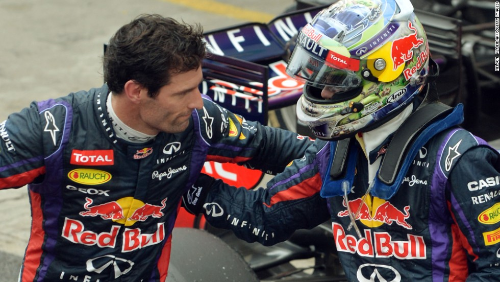 Vettel and Webber embrace after their one-two in the Brazilian Grand Prix to round off the 2013 season.