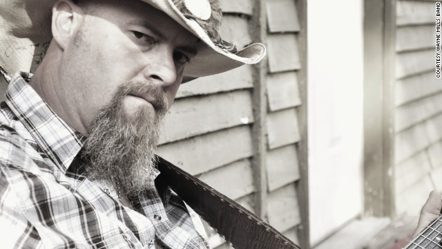 "Wayne Mills had been working on his seventh album, ""Long Hard Road,"" and touring small Southern venues."