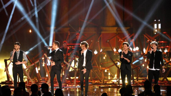 Zayn Malik (from left), Liam Payne, Harry Styles, Louis Tomlinson and Niall Horan of the boy band One Direction perform.