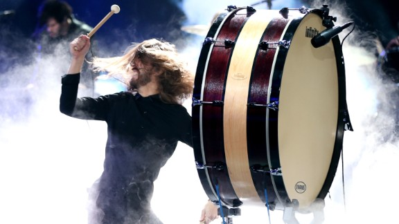 Wayne Sermon of Imagine Dragons bangs a drum during the band