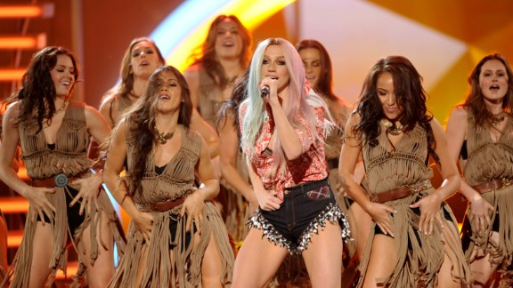 Ke$ha performs with backup dancers dressed like Native Americans.