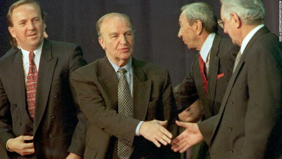 Bosnian President Alija Izetbegovic and Croatian President Franjo Tudjman shake hands after signing the Dayton Agreement in November 1995. The Dayton Agreement formally ended the war for Bosnia, a three-way conflict between Muslims, Serbs and Croats.