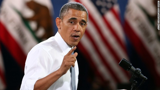 Obama heckled at immigration speech