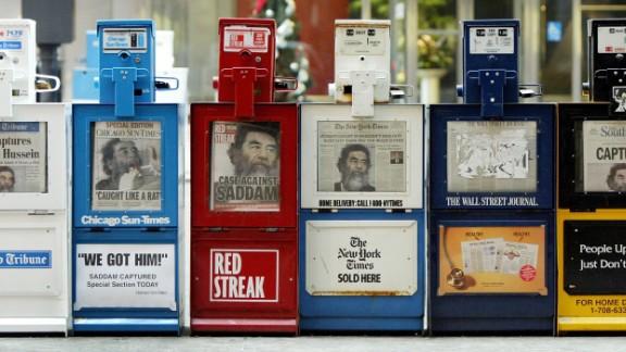 Hussein's capture is splashed across newspaper headlines in Chicago.