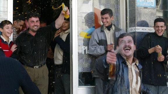 Iraqis celebrate in Nasiriyah, Iraq, after Hussein's capture.