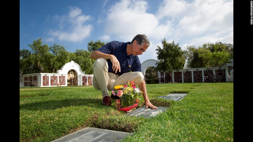 "CNN Hero Richard Nares visits the grave of his son, Emilio, in Oceanside, California. After Emilio died of leukemia in 2000, Nares started a program <a href=""http://www.cnn.com/2013/05/02/health/cnnheroes-nares-cancer-rides/index.html"">to provide transportation</a> for low-income families and their children battling cancer."