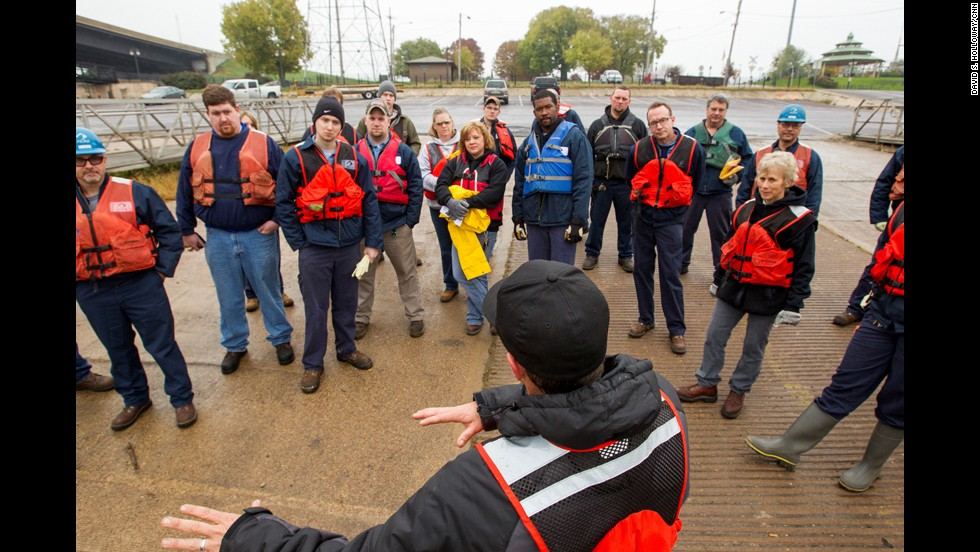 "Pregracke talks to volunteers during a recent cleanup of the Illinois River near Pekin, Illinois. ""The garbage got into the water one piece at a time,"" Pregracke says. ""And that's the only way it's going to come out."""