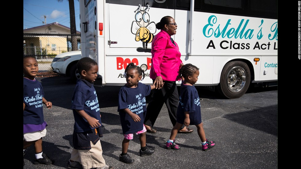 "Pyfrom walks with children to the <a href=""http://www.estellasbrilliantbus.org/"" target=""_blank"">Brilliant Bus</a>."