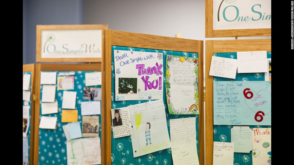 Thank-you notes line the walls of the One Simple Wish offices.