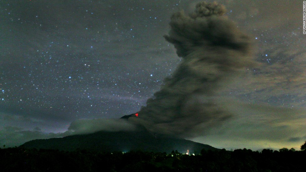 "NOVEMBER 25 - KARO, INDONESIA: A series of eruptions from Mount Sinabung volcano prompted authorities to raise the <a href=""http://science.time.com/2013/11/25/more-gases-erupt-from-rumbling-indonesian-volcano/"" target=""_blank"">alert status to the highest level on Sunday.</a> <a href=""http://science.time.com/2013/11/25/more-gases-erupt-from-rumbling-indonesian-volcano/"" target=""_blank"">About 15,000 people have been evacuated from 17 villages in the danger zone</a>, a 5-kilometer (3-mile) area around the crater, said the National Disaster Mitigation Agency."