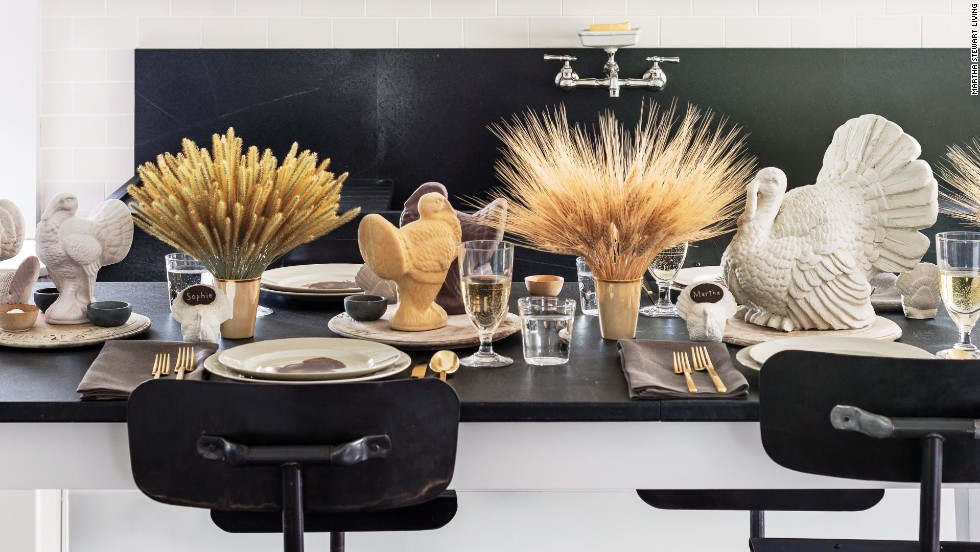The overall look of the tablescape is casual but inviting, and it is perfect for guests of all ages. The centerpieces are full but unfussy—bunches of Timothy grass, wheat, and foxtail gathered in gold lusterware cups. They alternate with old English carved breadboards, which hold the turkey sculptures, as well as various small stone vessels for salt and pepper. The only linens on the table are the napkins, which were made from beautiful linen yardage from a shop in Wiscasset, Maine.