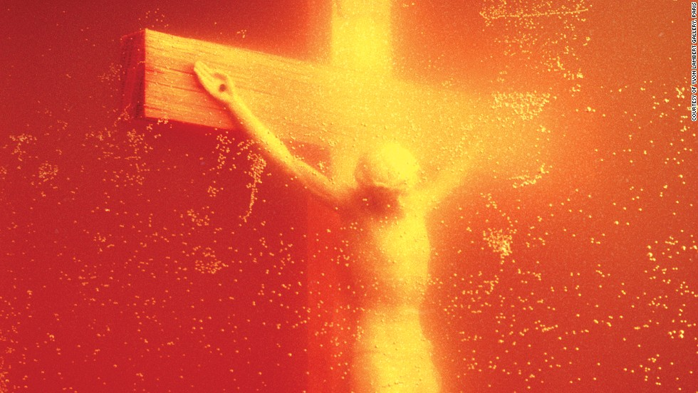 "<em>Piss Christ (1987), Andres Serrano</em><br /><br />Historically, repurposing religious iconography has been a surefire way to scandalize due to enduring cultural taboos. When Andres Serrano displayed ""Piss Christ,"" a photograph of a crucifix submerged in the artist's urine, it was widely seen as disrespectful to Christians. It eventually earned the condemnation of conservative U.S. Senators and sparked debates around the issue of public arts funding. Twenty-four years later, French Catholic fundamentalists destroyed a print of of the photo on display in Avignon. <br /><br />Though Serrano -- a Christian -- originally said that the piece had no specific political motivation, he has since suggested that it was meant to highlight the continued cheapening of the image of Christ, and the hypocrisy of those who twist the words of Christ to fit their own ends."
