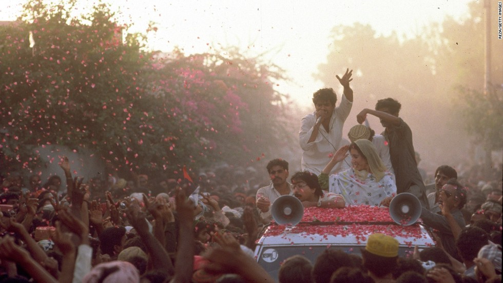 Crowds of supporters throw rose petals to greet Bhutto during the election campaign against President General Muhammad Zia-ul-Haq for the position of prime minister in October 1986 in Sindh, Pakistan.