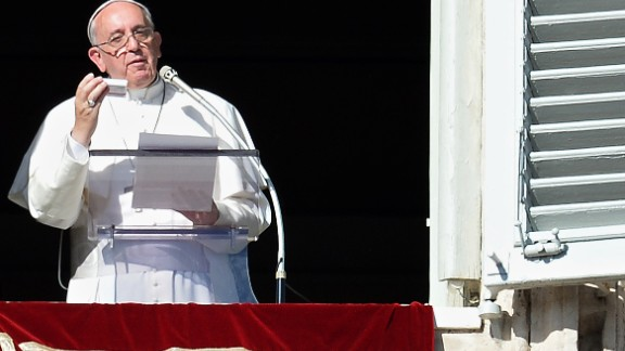 Pope Francis shows on November 17, 2013 a box containing a rosary during his Sunday Angelus prayer from the window of his appartment overlooking St.-Peter's square at the Vatican.