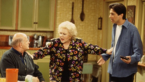 """We imagine Marie Barone (Doris Roberts) had to separate hubby Frank Barone (the late Peter Boyle) and son Ray (Ray Romano) during the holidays on """"Everybody Loves Raymond."""" In the comedy's third season, Marie decides to cook a tofu turkey for her entire family. Not only are the men horrified by the lack of meat at the table but daughter-in-law and ally in the tofu Thanksgiving, Debra (Patricia Heaton), is also horrified by the taste."""