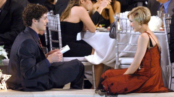 """Although Seth Cohen (Adam Brody) started out on """"The O.C."""" as a lonely teen, he eventually had two woman pursuing him at the same time. During the show's first Thanksgiving episode though, both realized that he was two-timing them leading to two women wanting his corpse on the dining room table, rather than the body of a dead turkey. Here Cohen is seen with Anna Stern (Samaire Armstrong)."""