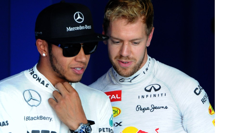 Mercedes driver Lewis Hamilton (left) says Vettel has been able to cruise to wins this season but he is one of several top drivers aiming to stop the German's era of dominance when new rules changes shake up the sport in 2014.