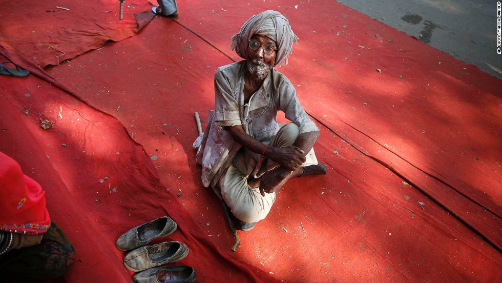 "NOVEMBER 27 - NEW DELHI, INDIA: An Indian man attends a protest demanding a universal pension of U.S.$32 per month for those above 60 years of age. The central government has proposed a pension of U.S.$3 per month. India is currently home to <a href=""http://www.helpage.org/global-agewatch/population-ageing-data/country-ageing-data/?country=India"" target=""_blank"">more than 100 million people aged 60 and over.</a>"