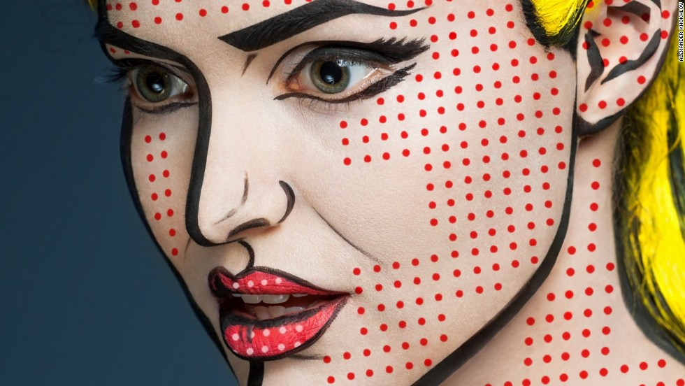 "Russian makeup artist Valeriya Kutsan's new series ""2D or not 2D"" transforms the faces of her subjects into works of pop art. In this image, the model's skin is covered in small red dots and her hair is painted with a bright yellow color to recreate one of Roy  Lichtenstein's comic-style paintings."