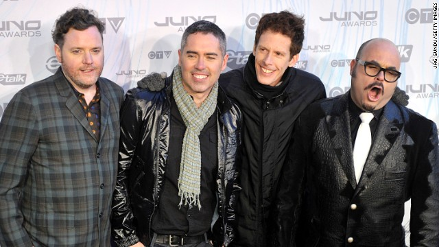 Kevin Hearn, Ed Robertson, Jim Creeggan and Tyler Stewart of Barenaked Ladies pose on the red carpet at the 2011 Juno Awards at the Air Canada Centre in 2011 in Toronto, Canada.