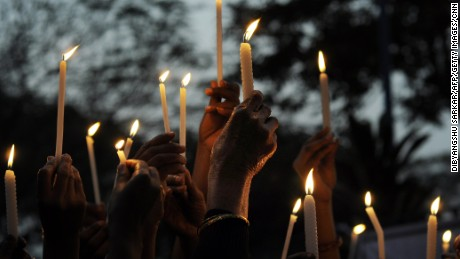 Indian activists hold a candlelight vigil on December 30 after the death of Nirbhaya.
