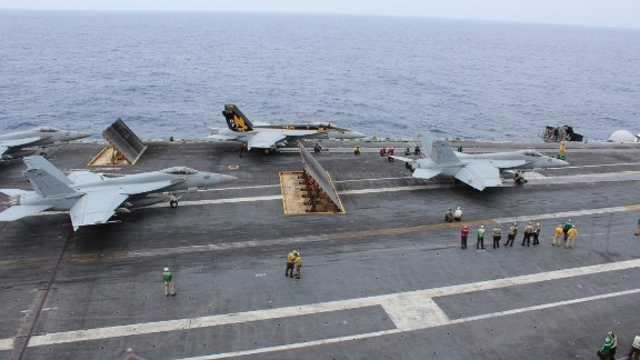 """Three fighters prepare to be catapulted off the USS George Washington during training exercises off Okinawa on November 27. They provide the cutting edge to the 90,000-ton """"super carrier."""""""