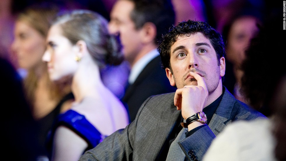 Actor Jason Biggs listens to presenters during the show.