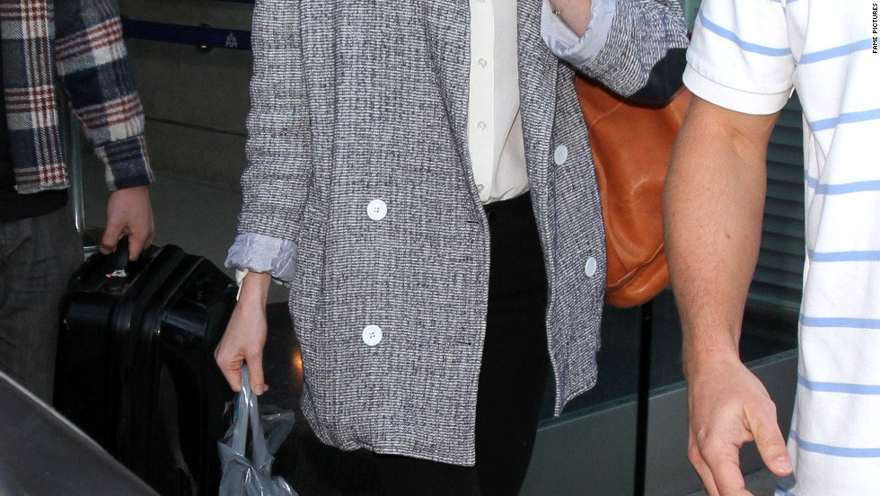 Emma Stone arrives back in Los Angeles for the holidays on November 27.
