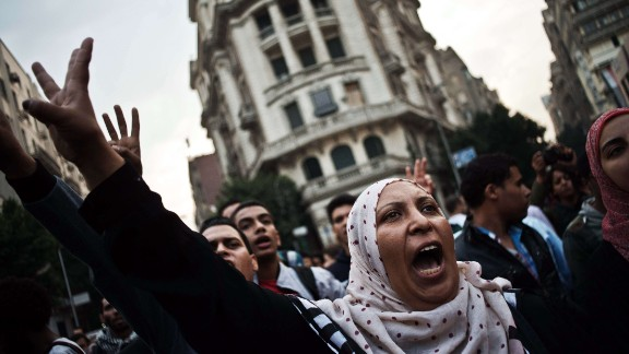 Egyptian Activists and members of the 6th of April movement shout slogans against the Egyptian Military on November 27, 2013, in Cairo. Egypt ordered the arrest of two prominent activists for defying a new law on demonstrations, as it widened its crackdown on protesters that so far targeted backers of ousted president Mohamed Morsi. TOPSHOTS/AFP PHOTO/GIANLUIGI GUERCIAGIANLUIGI GUERCIA/AFP/Getty Images